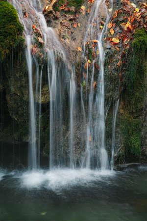 Thin streams of a mountain waterfall