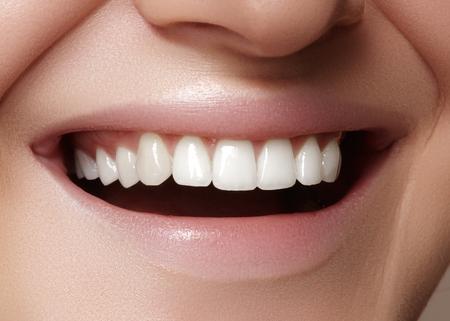 mouth smile: Beautiful smile with whitening teeth. Dental photo. Macro closeup of perfect female mouth, lipscare rutine Stock Photo