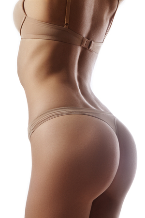 female butt: Beautiful female slim body. Beauty part of female body. Womans shape with clean skin.Diet and fitness.Healthy lifestyle. Ideal waist, perfect buttocks and legs, sexy back.