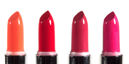 pomatum: Beautiful lip makeup set. Horizontal macro shot with bright lipticks. Fashion lips make-up collection. Hot visage backround with red pomade