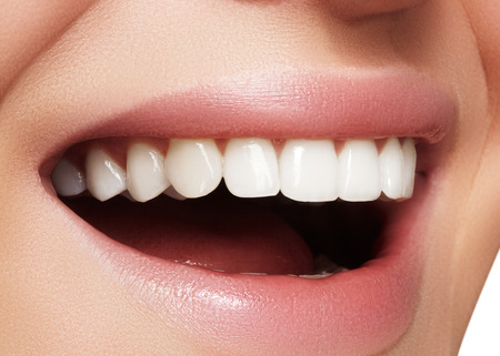 Beautiful smile with whitening teeth. Dental photo. Macro closeup of perfect female mouth, lipscare rutine Foto de archivo