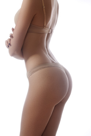 Beautiful female slim body. Beauty part of female body. Womans shape with clean skin.Diet and fitness.Healthy lifestyle. Ideal waist, perfect buttocks and legs, sexy back.