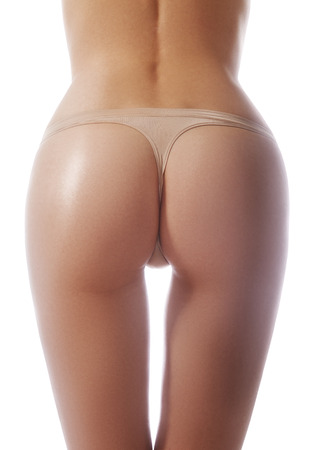 Beautiful female body part. Sexy female buttocks isolated on white background. Perfect sport figure, healthy lifestyle, diet