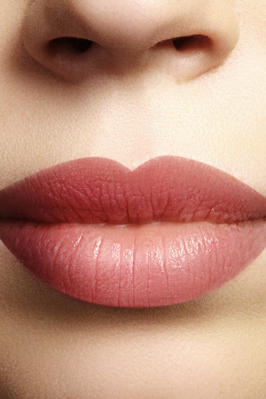 Sweet kiss. Perfect natural lip makeup. Close up macro photo with beautiful female mouth. Plump full lips. Close-up face detail. Perfect clean skin, light fresh lip make-up. Beautiful spa tender lip. Zdjęcie Seryjne