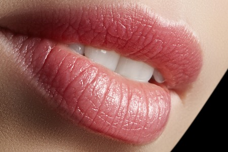 Sweet kiss. Perfect natural lip makeup. Close up macro photo with beautiful female mouth. Plump full lips. Close-up face detail. Perfect clean skin, light fresh lip make-up. Beautiful spa tender lip. Stock Photo