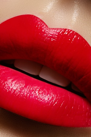 Beautiful female Lips. Sweet Kiss with red lipstick. Lip Make-up on macro shoot. Hot fashion lip makeup. Great for Valentines day