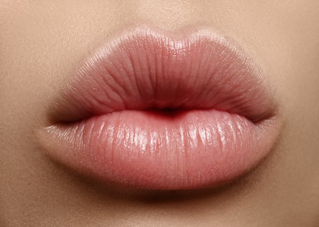 Close-up perfect natural lip makeup beautiful female mouth. Plump sexy full lips. Macro photo face detail. Perfect clean skin, fresh lip make-up. Beautiful spa tender lips Foto de archivo