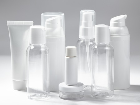 White cosmetic bottles on white background. Wellness, spa and body care bottles collection. Beauty treatment, bathroom set