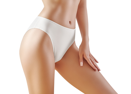 Spa and wellness. Healthy slim body in white panties. Beautiful sexy hips with clean skin. Fitness or plastic surgery. Perfect buttocks without cellulite. Stock Photo