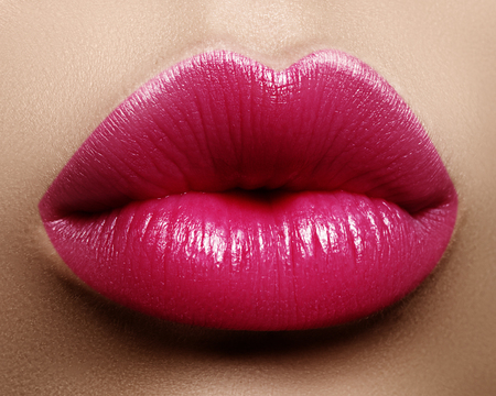 Close-up perfect lip makeup beautiful female mouth. Plump sexy full lips. Macro photo face detail. Perfect clean skin, fresh lip make-up. Sweet pink lipstick, magenta color. Valentine's day style