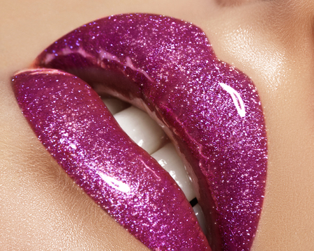 Glamour magenta gloss lip make-up. Fashion makeup beauty shot. Close-up female sexy full lips with celebrate pink gloss lipstick