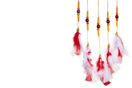 Red Feathers Curtain. Dream Catcher Native American on White. Boho Hippie Style. Ethnic Symbol for Good Dreams and Rest. Handmade concept