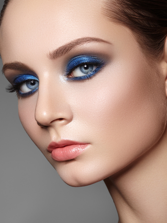 Beautiful Woman with Professional Makeup. Celebrate Style Eye Make-up, Perfect Eyebrows, Shine Skin. Bright Fashion Look. Blue Color of Eyeshadows. Christmas Winter Image