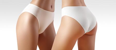 Terme e benessere. Corpo snello sano in mutandine bianche. Bei fianchi con pelle pulita. Fitness o chirurgia plastica. Perfetto senza cellulite.