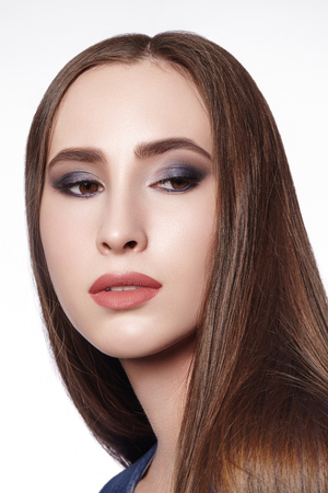 Beautiful Woman with Professional Makeup. Celebrate Style Eye Make-up, Perfect Eyebrows, Shine Skin. Bright Fashion Look.