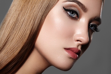 Beautiful Woman with Professional Makeup. Celebrate Style Eye Make-up, Perfect Eyebrows, Shine Skin. Bright Fashion Look. Black Liner, Shimmer Powder and Silver Eyeshadows