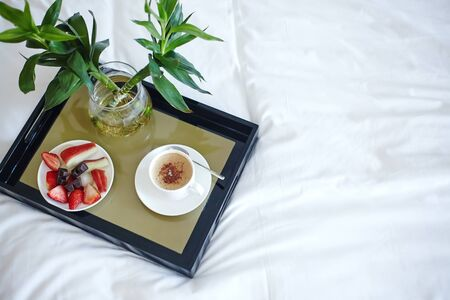 Mood with Coffee in Bed. Beautiful Life. Top View Tray with Fruits and Espresso on White Sheet. Luxury Lifestyle. Good Glamour Morning