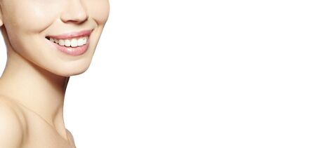 Beautiful Part of Face Young Woman with White Teeth on White Background. Happy Smile. Wellness and Tooth Care. Copy Space
