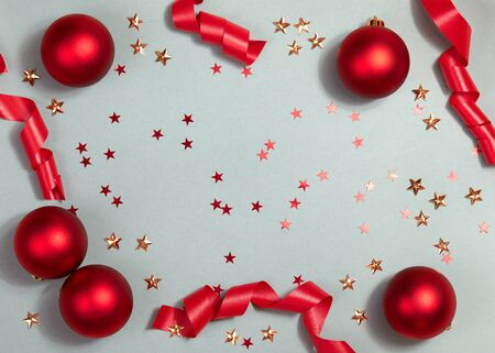 Beautiful Christmas Background with Shiny Red Balls and Ribbon in Bright Color. Top view with Copy Space.