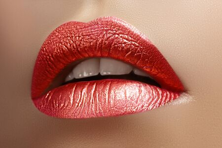 Beautiful Closeup with Female Plump Lips with Shiny Pink Makeup. Fashion Celebrate Make-up, Glitter Cosmetic. Metalic Lip Makeup