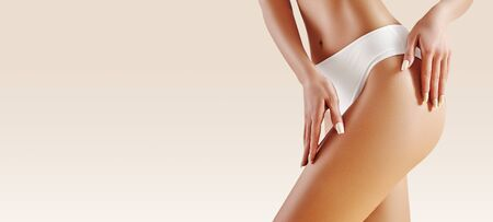Spa and wellness. Healthy slim body in white panties. Beautiful sexy hips with clean skin. Fitness or plastic surgery. Perfect buttocks without cellulite. Stockfoto