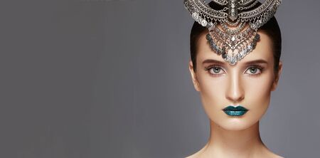 Beautiful Woman with Silver Diadem. Modern Indian Fashion Style. Jewelry Luxury Accessories. Bright Make-up, sexy metallic Lips