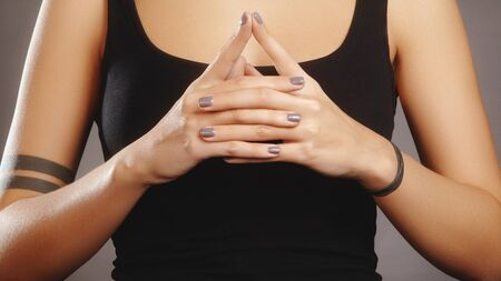 Woman hands in mudra symbol. Symbolic or ritual gesture in Hinduism and Buddhism. Self-healing and self-making practice. Relaxation in yoga