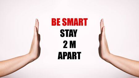 Be Smart, Stay 2m Apart. Distancing and Contact-less Greetings. Healthcare Poster with Red Inscription. Two Hands Gesture Limit Social Distance. Public Health Concept Foto de archivo
