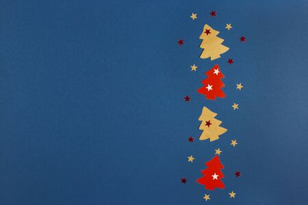 Christmas banner with Xmas tree and stars handmade on blue background with copy space. Flat lay.