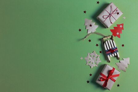 Christmas banner with gift boxes, sledges, Xmas tree, snowflakes and stars handmade on mint background with copy space.