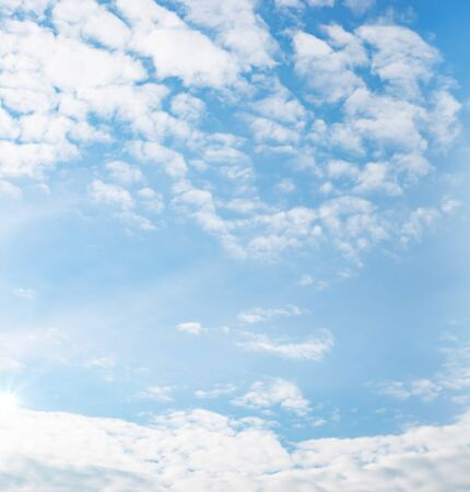 Beautiful blue sky with white clouds. Natural background with a copy space