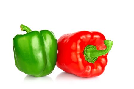 Two bell peppers: red and green isolated on a white background. Close up.