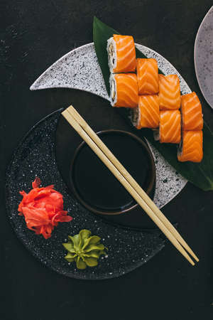 Sushi with salmon, cream cheese Philadelphia, cucumber and wasabi