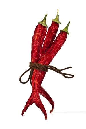 Red chili peppers tied by rope isolated on the white background Stock Photo - 15538447