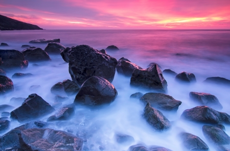 Stones in the sea with long exposure Stock Photo