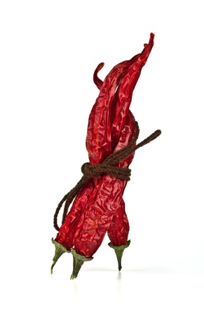 Three red chili peppers tied by rope on the white background Stock Photo