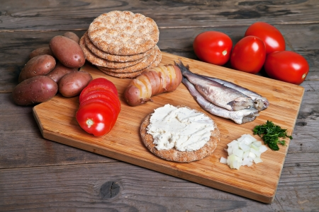 Swedish herring with potato and tomato on the desk Stock Photo - 16058974