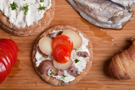 Sandwich with swedish herring on the table