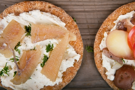 Two toasts with surstromming and caviar on the table Stock Photo