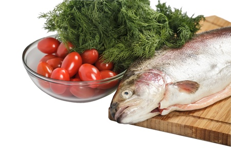 Salmon on the cutting board with greenery  Isolated