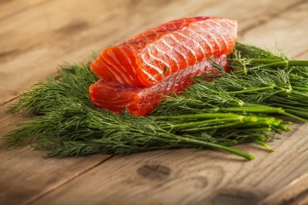 Two pieces of gravlax on the greenery