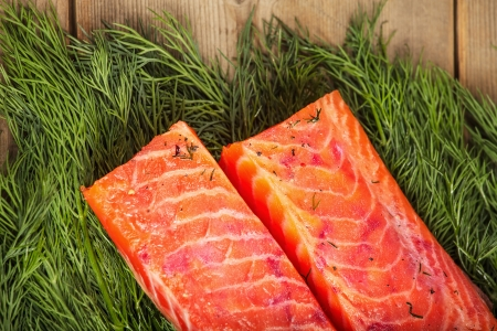 Two big pieces of salty salmon on the wooden table Stock Photo