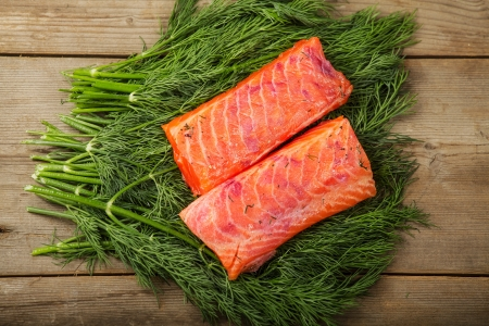 Two pieces of gravad lax on the table with some greenery