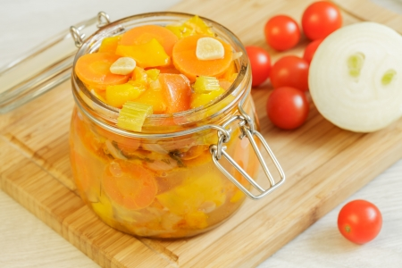 Vegetables homemade stew in the glass jar and ingredients on the cutting board Stock Photo