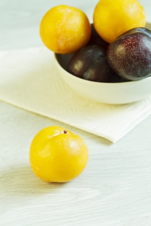 Mirabelle and many other plums in the bowl Stock Photo