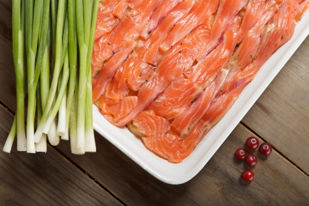 A dish with Swedish fish meal - gravlax, prepared for baking