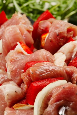 Shashlik - Oriental food  The piec�es of raw meat on the skewers  Closeup  Limited depth of field  Stock Photo
