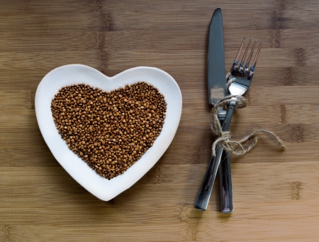 buckwheat: Buckwheat in a heart-shaped plate Stock Photo