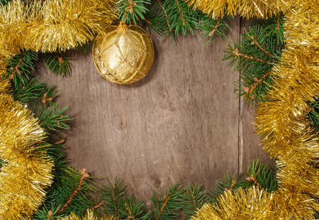 tinsel, gold ball, tangerines and christmas tree