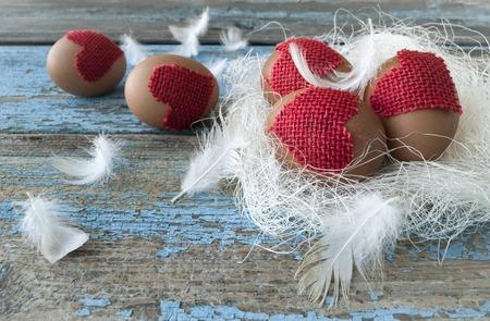 eastertime: Easter Eggs in the nest on wooden background